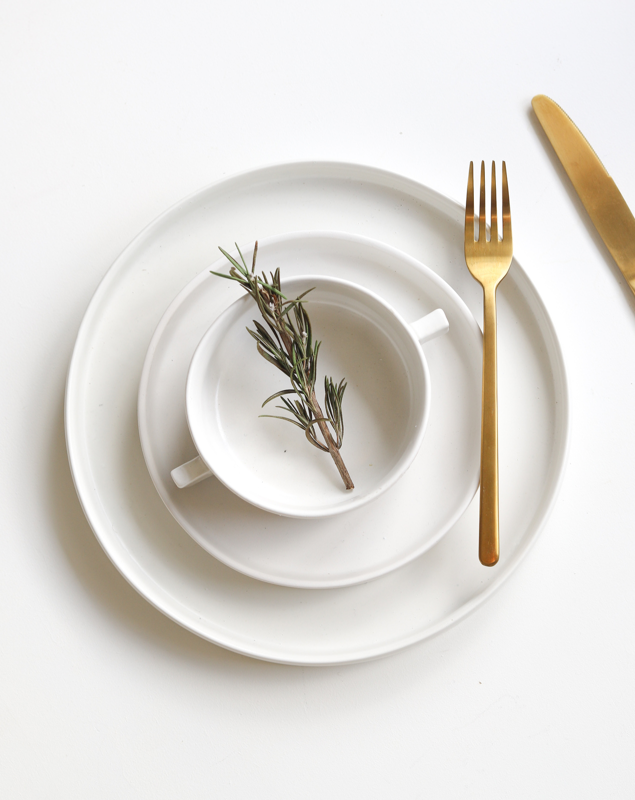 Combiantion of Gold Fork and Knife and White Ceramic Plates