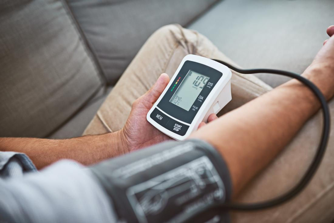 man-measuring-his-own-blood-pressure-with-band-and-monitor Omron