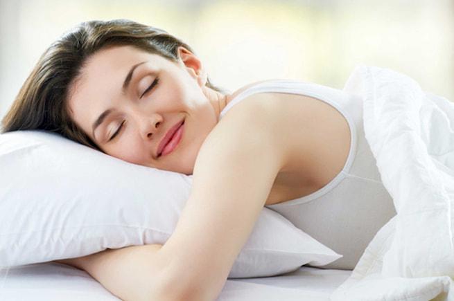 girl sleeping on bamboo pillow