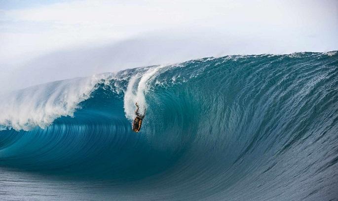 guy cruising through waves