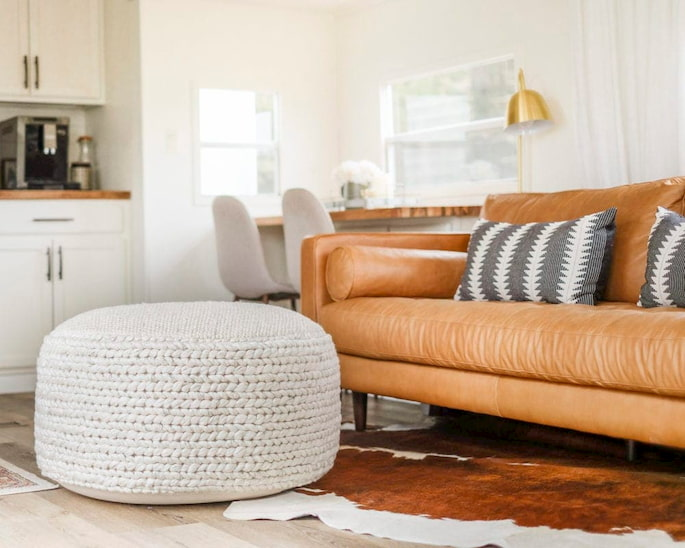 living room with sofa bed and pouf