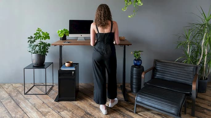 girl standing in front of the standing desk