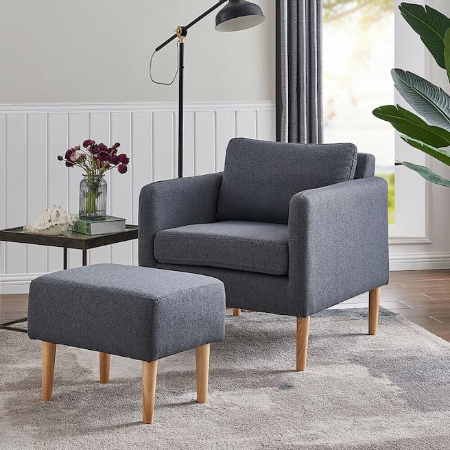 relaxing grey accent chair with ottoman and reading lamp in the bedroom