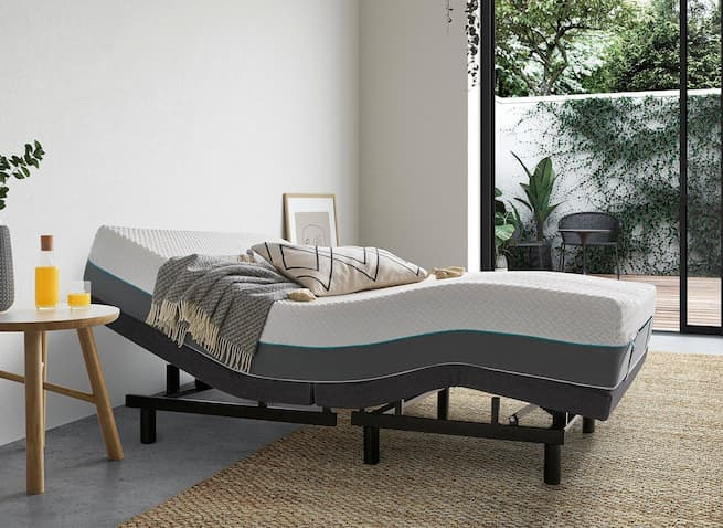 adjustable bed for bedroom with side table pillow throw and decorative frame