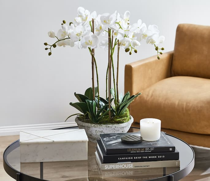 coffee table with books and flowers