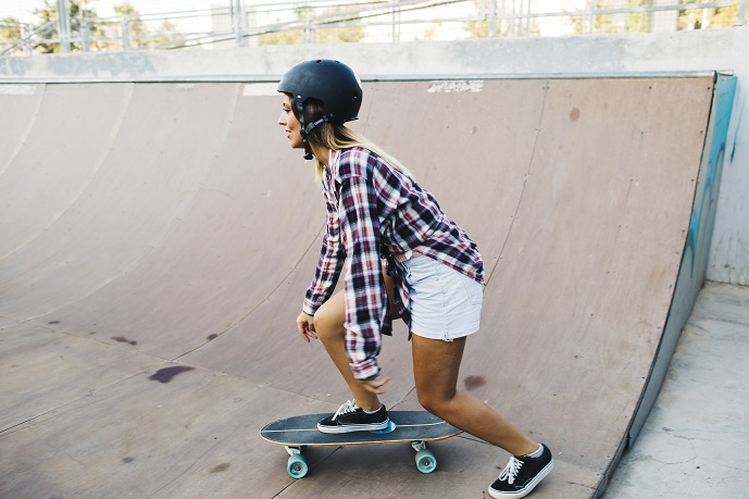 picture of a girl skateboarding with a helmet