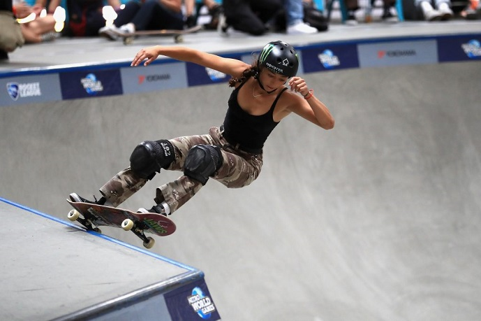 picture of a girl skateboarding with a protective gear
