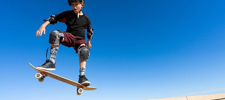 picture of a kid skateboarding with protective gear